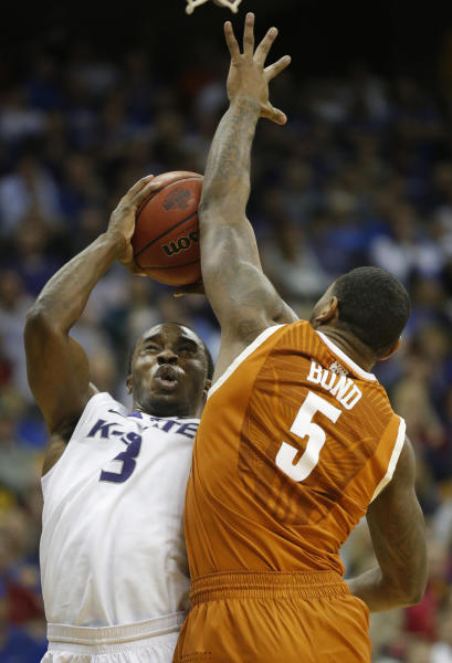 Kansas State guard Martavious Irving (3) shoots over Texas forward Jaylen Bond (5) during the second half of an NCAA college basketball game in the Big 12 tournament on Thursday, March 14, 2013, in Kansas City, Mo. Kansas State defeated Texas 66-49. (AP Photo/Orlin Wagner)