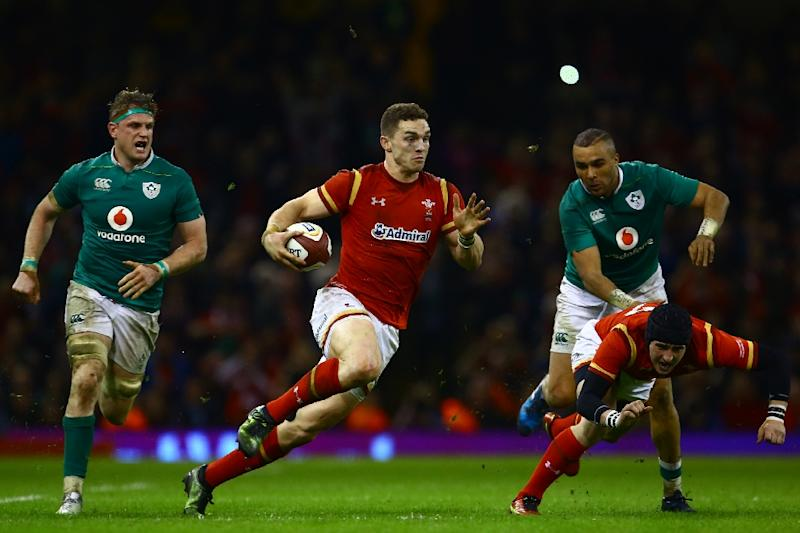 Wales' wing George North (C) makes a break during the Six Nations rugby union match against Ireland at the Principality Stadium in Cardiff, south Wales, on March 10, 2017