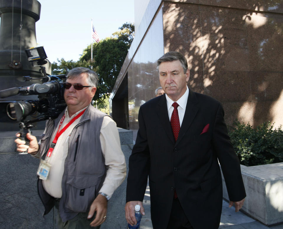 Jamie Spears, right, father of singer Britney Spears, leaves the Stanley Mosk Courthouse Wednesday, Oct. 24, 2012, in Los Angeles. Britney Spears' ex-manager, Sam Lutfi, who is suing Spears' parents for defamation, testified Wednesday while they watched from across the courtroom. (AP Photo/Nick Ut)