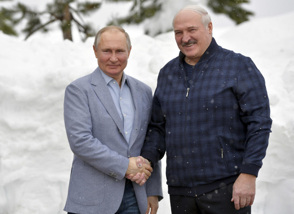 Russian President Vladimir Putin, left, and Belarusian President Alexander Lukashenko pose for a photo during their meeting in the Black Sea resort of Sochi, Russia, Monday, Feb. 22, 2021. (Alexei Druzhinin, Sputnik, Kremlin Pool Photo via AP)