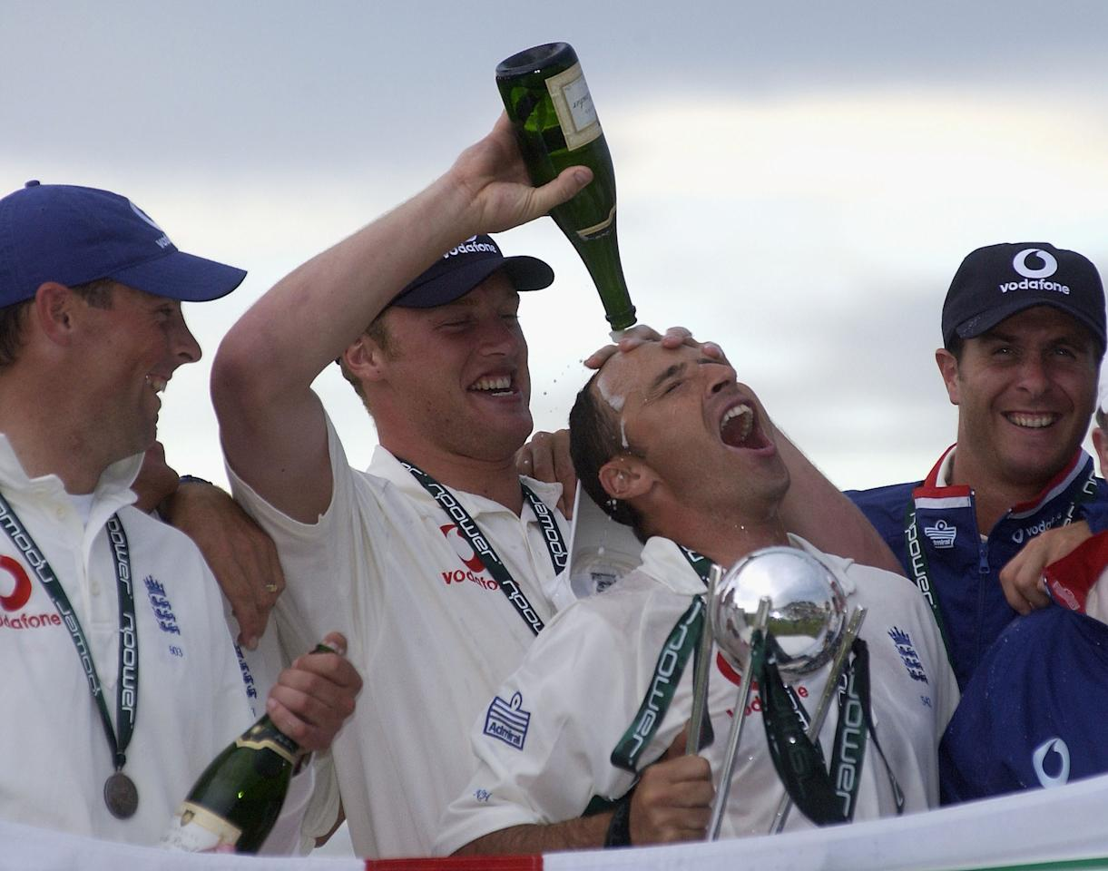 OLD TRAFFORD - JUNE 17:  Nasser Hussain of England celebrates winning with the trophy and Andrew Flintoff during the npower 3rd Test Match at Old Trafford Cricket Ground, Manchester, England on June 17, 2002. ( Photo By Tom Shaw / Getty Images)