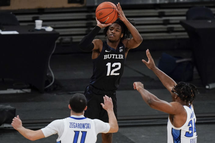 Butler's Myles Tate (12) shoots over Creighton's Denzel Mahoney (34) and Marcus Zegarowski (11) during the first half of an NCAA college basketball game in the Big East conference tournament Thursday, March 11, 2021, in New York. (AP Photo/Frank Franklin II)