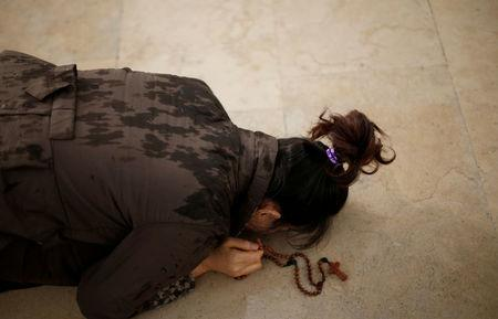 FILE PHOTO: A pilgrim lies prostrate as she walks on her knees to fulfil her vows, as pilgrims attend the 99th anniversary of the appearance of the Virgin Mary to three shepherd children, at the Catholic shrine of Fatima, Portugal, May 12, 2016. REUTERS/Rafael Marchante/File Photo