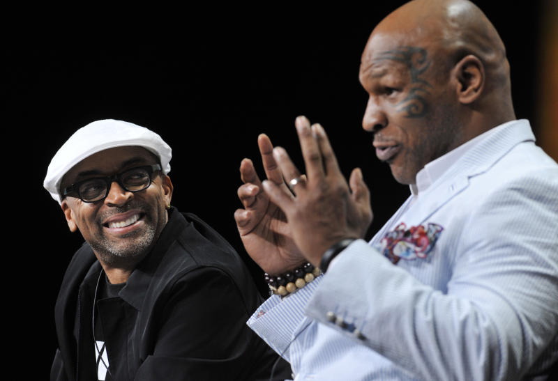 """Spike Lee, left, director of """"Mike Tyson: Undisputed Truth,"""" listens as Tyson answers a question during HBO's Summer 2013 TCA panel at the Beverly Hilton Hotel on Thursday, July 25, 2013, in Beverly Hills, Calif. (Photo by Chris Pizzello/Invision/AP)"""