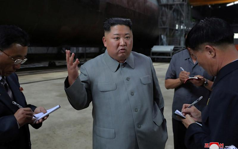 North Korean leader Kim Jong Un visits a submarine factory in an undisclosed location, North Korea - REUTERS