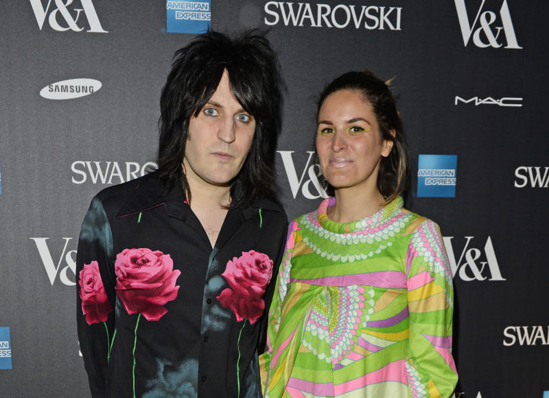 LONDON, ENGLAND - MARCH 14: Noel Fielding (L) and Lliana Bird arrive at the Alexander McQueen: Savage Beauty VIP private view at the Victoria and Albert Museum on March 14, 2015 in London, England. (Photo by David M. Benett/Getty Images for Victoria and Albert Museum)