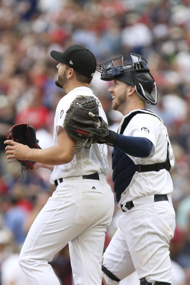Minnesota Twins' catcher Mitch Garver celebrates with pitcher Lewis Thorpe after winning 7-4 against the Detroit Tigers during a baseball game Sunday, Aug. 25, 2019, in Minneapolis. (AP Photo/Stacy Bengs)