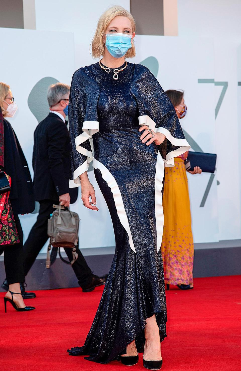 """<p>The 77th annual Venice Film Festival marked the first major red carpet since the pandemic started, and on Sept. 2 <a href=""""https://people.com/style/cate-blanchett-red-carpet-style-venice-film-festival-2020/"""" rel=""""nofollow noopener"""" target=""""_blank"""" data-ylk=""""slk:style icon Cate Blanchett"""" class=""""link rapid-noclick-resp"""">style icon Cate Blanchett</a> used it to promote sustainability (<a href=""""https://people.com/style/cate-blanchett-rewears-esteban-cortazar-gown-at-venice-film-festival/"""" rel=""""nofollow noopener"""" target=""""_blank"""" data-ylk=""""slk:rewearing an Esteban Cortazar gown from 2015"""" class=""""link rapid-noclick-resp"""">rewearing an Esteban Cortazar gown from 2015</a>) and safety (posing with a mask). It doesn't get more 2020 than that!</p>"""