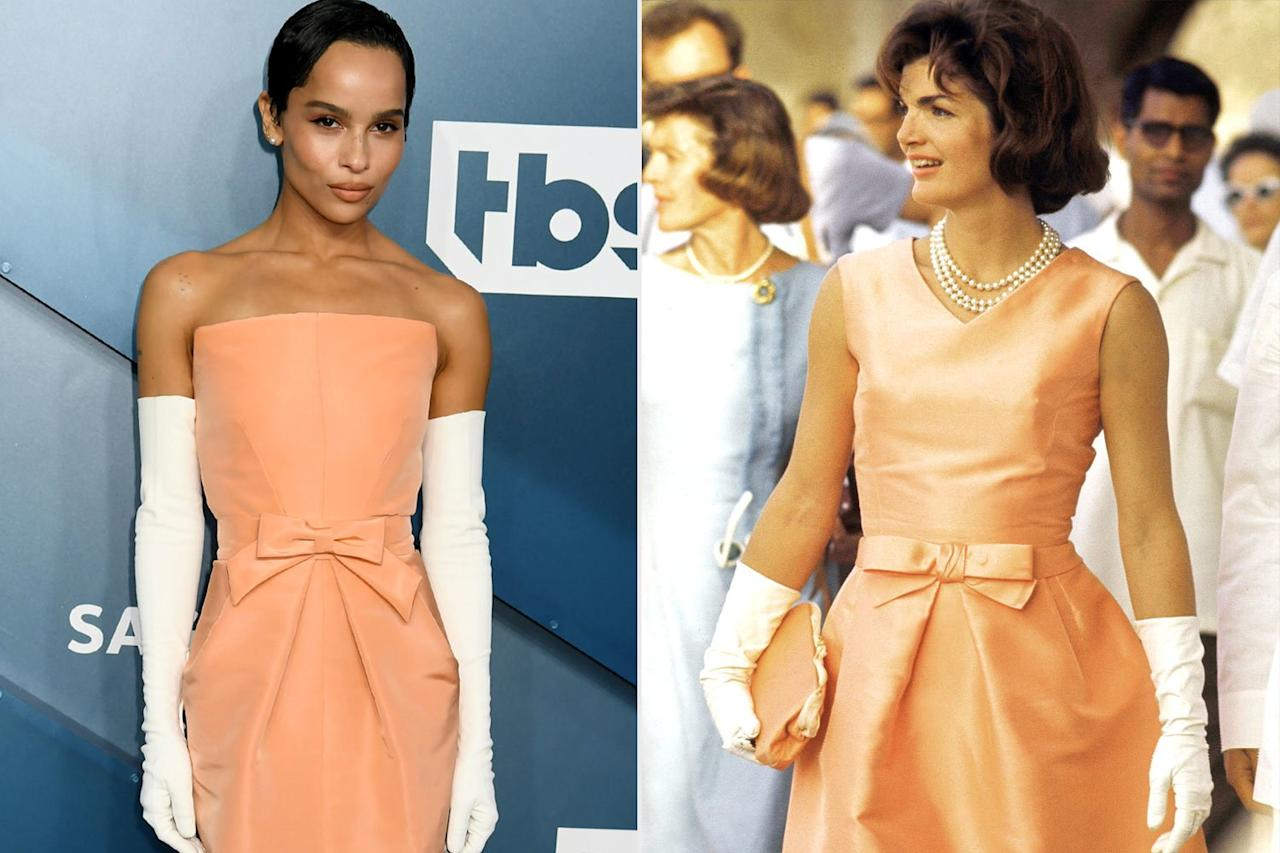 """Zoë Kravitz's peach-colored Oscar de la Renta gown with bow-adorned belt and white gloves was actually a recreation of a dress Jackie Kennedy wore in India in 1962. Kravitz's stylist <a href=""""https://www.instagram.com/ajmukamal/?hl=en"""">Andrew Mukamal</a> revealed on Instagram that the former First Lady was the source of the look, and together with the fashion house, they reworked the original design switching up the neckline and hem slightly to suit Zoë's aesthetic."""