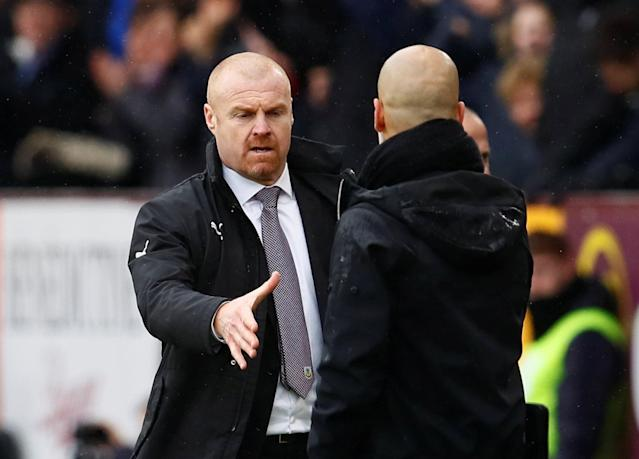 "Soccer Football - Premier League - Burnley vs Manchester City - Turf Moor, Burnley, Britain - February 3, 2018 Burnley manager Sean Dyche shakes hands with Manchester City manager Pep Guardiola at the end of the match Action Images via Reuters/Jason Cairnduff EDITORIAL USE ONLY. No use with unauthorized audio, video, data, fixture lists, club/league logos or ""live"" services. Online in-match use limited to 75 images, no video emulation. No use in betting, games or single club/league/player publications. Please contact your account representative for further details."
