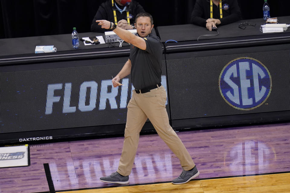 Florida head coach Mike White directs his team during the second half of a college basketball game against Oral Roberts in the second round of the NCAA tournament at Indiana Farmers Coliseum, Sunday, March 21, 2021 in Indianapolis. (AP Photo/AJ Mast)
