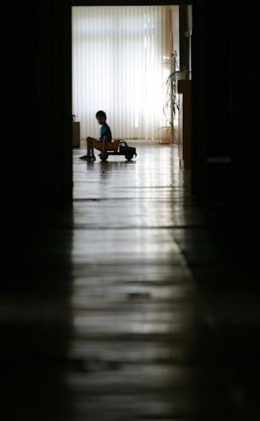 Young children are growing up with HIV and AIDS in Russia (AFP Photo/MAXIM MARMUR)