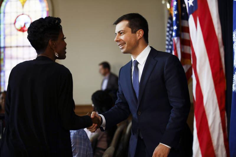 Democratic presidential candidate former South Bend, Ind., Mayor Pete Buttigieg, right, greets Stephania Priester at a roundtable discussing health equity, Thursday, Feb. 27, 2020, at the Nicholtown Missionary Baptist Church in Greenville, S.C. (AP Photo/Matt Rourke)