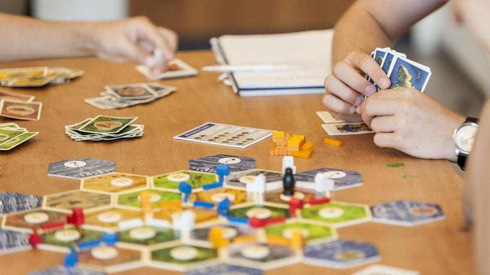 Mandatory Credit: Photo by Stephen Chung / Lnp / Shutterstock (4990337b) Competitors play settlers at CatanMind Sports Olympiad, London, Great Britain - August 23, 2015Mind Sports Olympiad 2015, the annual board game festival.