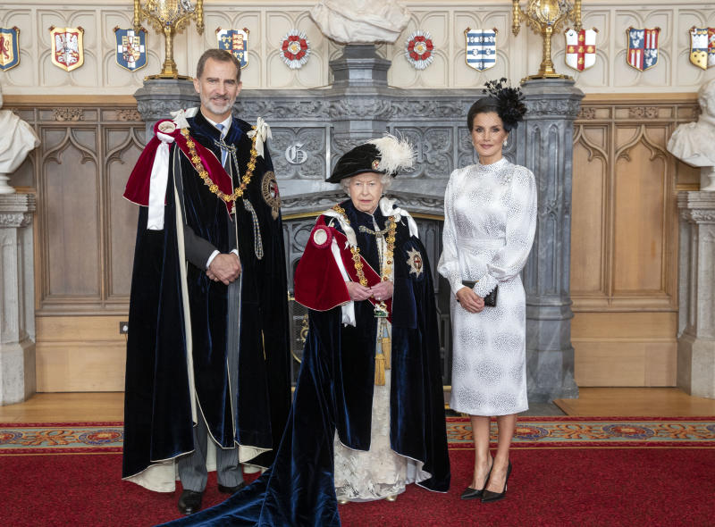Queen Elizabeth II (centre) with King Felipe VI of Spain and his wife, Queen Letizia, in St George's Hall, at Windsor Castle, after the king was invested as a Supernumerary Knight of the Garter, ahead of the Order of the Garter Service at St George's Chapel.