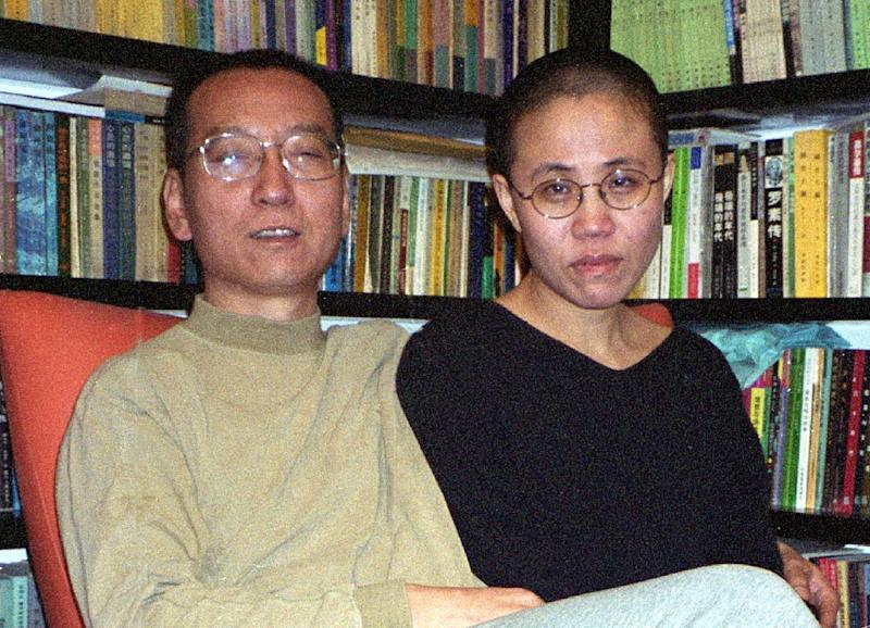 File photo released by the Liu's family and taken on October 22, 2002 shows Chinese dissident and Nobel Peace laureate Liu Xiaobo and his wife Liu Xia in Beijing (AFP Photo/)