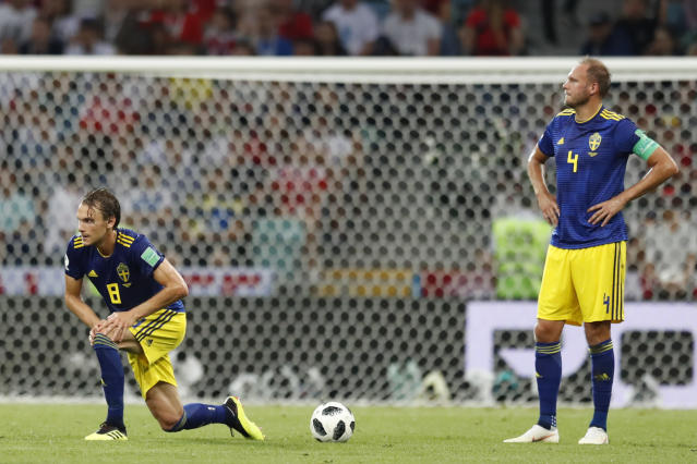 Sweden's Andreas Granqvist, left, and teammate Andreas Granqvist gestures during the group F match between Germany and Sweden at the 2018 soccer World Cup in the Fisht Stadium in Sochi, Russia, Saturday, June 23, 2018. (AP Photo/Rebecca Blackwell)