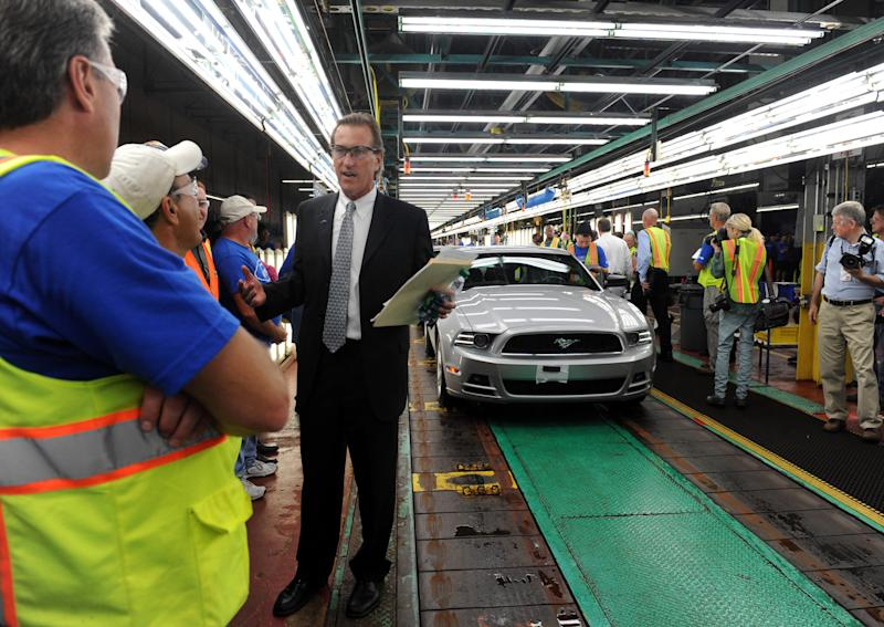 Tim Young, the plant manager, visits with the lineworkers, as a 2014 Ford Mustang appears on the line in Flatrock, Mich. on Thursday, Aug. 29, 2013. For the first time, Ford is making its Fusion sedan in the U.S. The company's Flat Rock, Mich., plant began making the Fusion on Thursday. (AP Photo/Detroit News, Charles V. Tines)