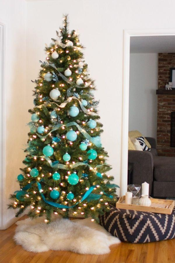 """<p>DIY painted ornaments in a custom rainbow of your favorite shade can help you design your own ombré tree.</p><p><strong><em>Get the tutorial at <a href=""""https://lovelyindeed.com/diy-ombre-christmas-tree/"""" rel=""""nofollow noopener"""" target=""""_blank"""" data-ylk=""""slk:Lovely Indeed"""" class=""""link rapid-noclick-resp"""">Lovely Indeed</a>.</em></strong></p><p><a class=""""link rapid-noclick-resp"""" href=""""https://www.amazon.com/Christmas-Transparent-Fillable-Ornament-Decoration/dp/B08L3FH2LG?tag=syn-yahoo-20&ascsubtag=%5Bartid%7C10070.g.2025%5Bsrc%7Cyahoo-us"""" rel=""""nofollow noopener"""" target=""""_blank"""" data-ylk=""""slk:SHOP CLEAR ORNAMENTS"""">SHOP CLEAR ORNAMENTS</a></p>"""