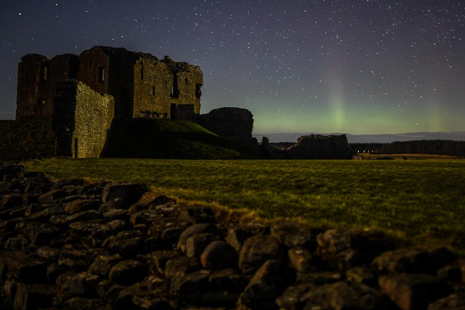 DUFFUS, SCOTLAND - FEBRUARY 20: The Aurora Borealis is seen above the ruins of Duffus Castle on February 20, 2021 in Duffus, Scotland. The Aurora Borealis, more commonly known as the Northern Lights, occurs when solar winds drive charged particles from the sun which strike atoms and molecules in Earths atmosphere causing the light show. (Photo by Peter Summers/Getty Images)