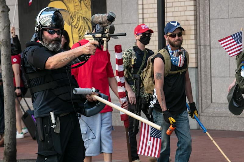 The Proud Boys, an alt-right group, faces off against Black Lives Matters protesters using mace and a paint ball gun on August 15, 2020 in downtown Portland, Oregon. Demonstrations have occurred on almost a nightly basis in Portland since the killing of George Floyd. (Paula Bronstein/Getty Images)