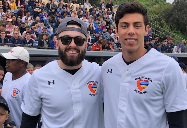 """Cleveland Browns quarterback <a class=""""link rapid-noclick-resp"""" href=""""/nfl/players/30971/"""" data-ylk=""""slk:Baker Mayfield"""">Baker Mayfield</a> joined the celebrity softball game hosted by co-founder <a class=""""link rapid-noclick-resp"""" href=""""/mlb/players/9320/"""" data-ylk=""""slk:Christian Yelich"""">Christian Yelich</a> (right) in Malibu on Sunday. (California Strong/Instagram)"""