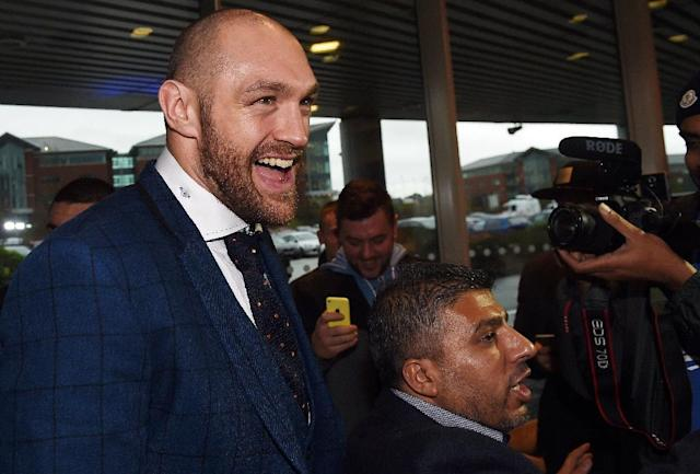 Britain's world heavyweight champion Tyson Fury, pictured in Bolton on November 30, 2015, opted to travel home by car from Germany via the Dutch port of Rotterdam, taking a ferry to Hull (AFP Photo/Paul Ellis)