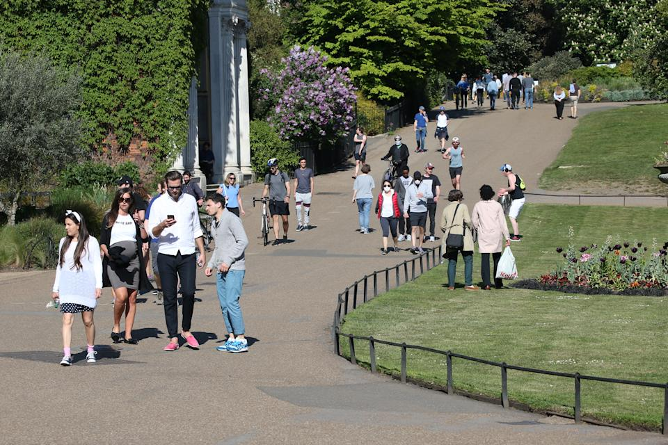 People walking in Kensington Gardens, London, as the UK continues in lockdown to help curb the spread of the coronavirus. PA Photo. Picture date: Saturday April 25, 2020. See PA story HEALTH Coronavirus. Photo credit should read: Jonathan Brady/PA Wire