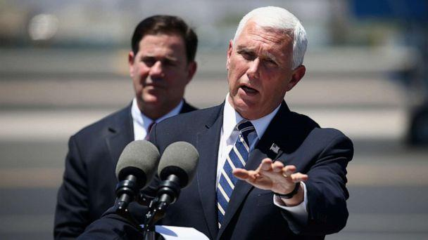 PHOTO: Vice President Mike Pence, right, answers a question as he holds a news conference with Arizona Gov. Doug Ducey, left, after their meeting to discuss the surge in coronavirus cases in Arizona Wednesday, July 1, 2020, in Phoenix. (Ross D. Franklin/AP)