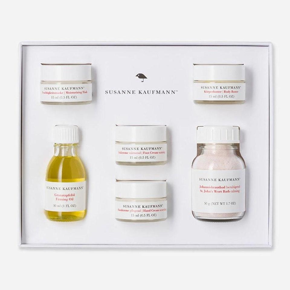 """<p>If your grandmother is not yet familiar with the skin-care majesty that is Susanne Kaufmann, you may need to explain to her what a boon it is to get six miniature versions of her products for $75. The calming St. John's Wort Bath, Warming Foot Cream, Body Butter, Hand Cream, Firming Oil, and Moisturizing Mask will get Grandma hooked on this Austrian import, thanks to the skin-reinvigorating head-to-toe experience.</p> <p><strong>$75</strong> (<a href=""""https://www.beautyhabit.com/collections/whats-new/products/susanne-kaufmann-limited-edition-home-spa-box"""" rel=""""nofollow noopener"""" target=""""_blank"""" data-ylk=""""slk:Shop Now"""" class=""""link rapid-noclick-resp"""">Shop Now</a>)</p>"""