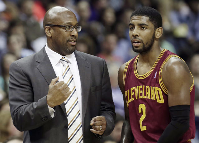 Cleveland Cavaliers coach Mike Brown, left, talks with Kyrie Irving during the first half of an NBA basketball game against the Memphis Grizzlies in Memphis, Tenn., Saturday, March 1, 2014. (AP Photo/Danny Johnston)