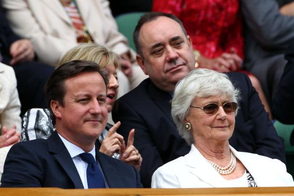 British Prime Minister David Cameron, his mother Mary Cameron and First Minister of Scotland Alex Salmond (Back) sit in the Royal Box during the Gentlemen's Singles final match between Roger Federer of Switzerland and Andy Murray of Great Britain on day thirteen of the Wimbledon Lawn Tennis Championships at the All England Lawn Tennis and Croquet Club on July 8, 2012 in London, England. (Photo by Clive Brunskill/Getty Images)