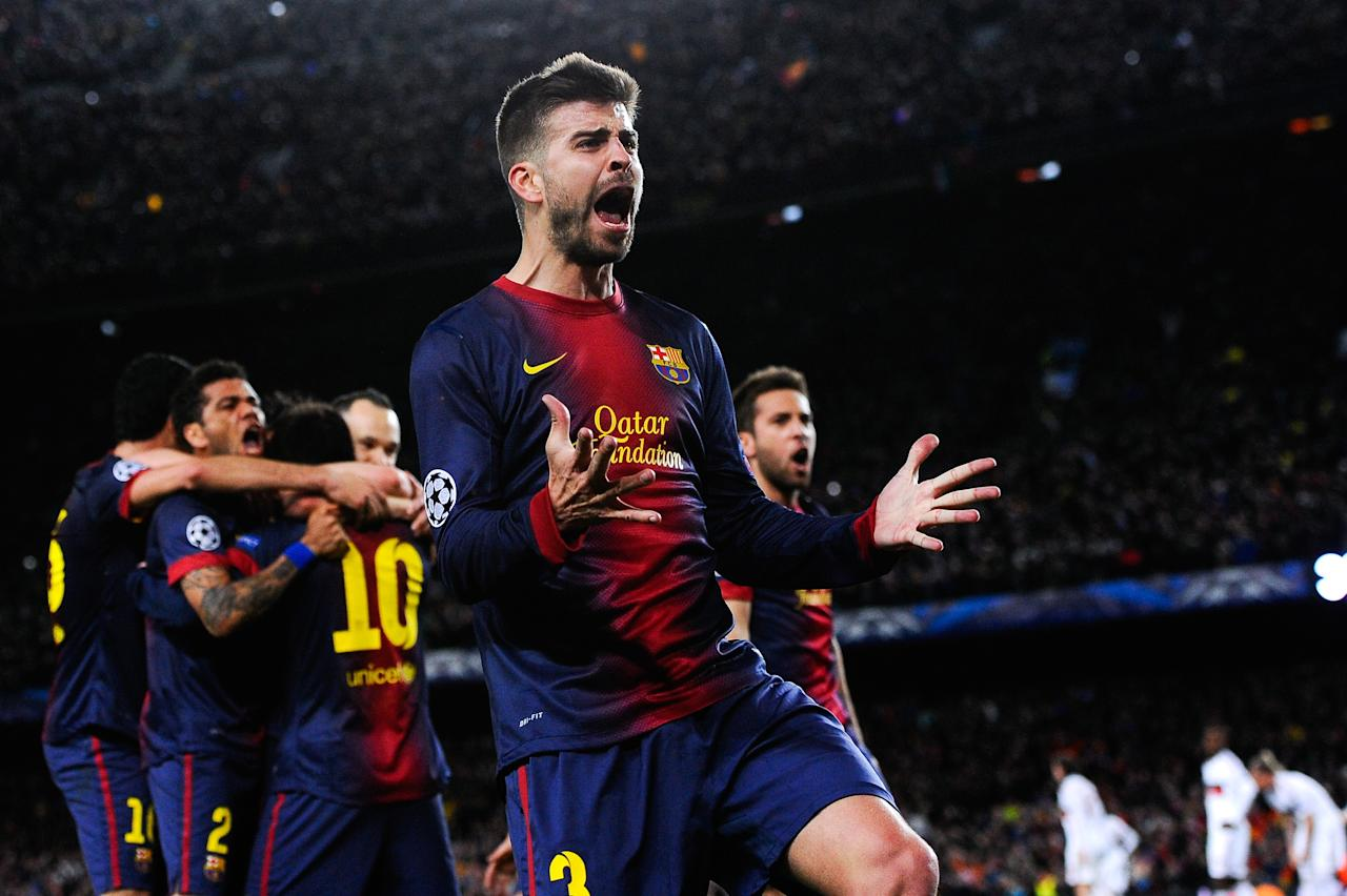 BARCELONA, SPAIN - MARCH 12:  Gerard Pique of FC Barcelona celebrates after Lionel Messi of FC Barcelona scored his team's second goal during the UEFA Champions League round of 16 second leg match between FC Barcelona and AC Milan at the Camp Nou Stadium on March 12, 2013 in Barcelona, Spain.  (Photo by David Ramos/Getty Images)