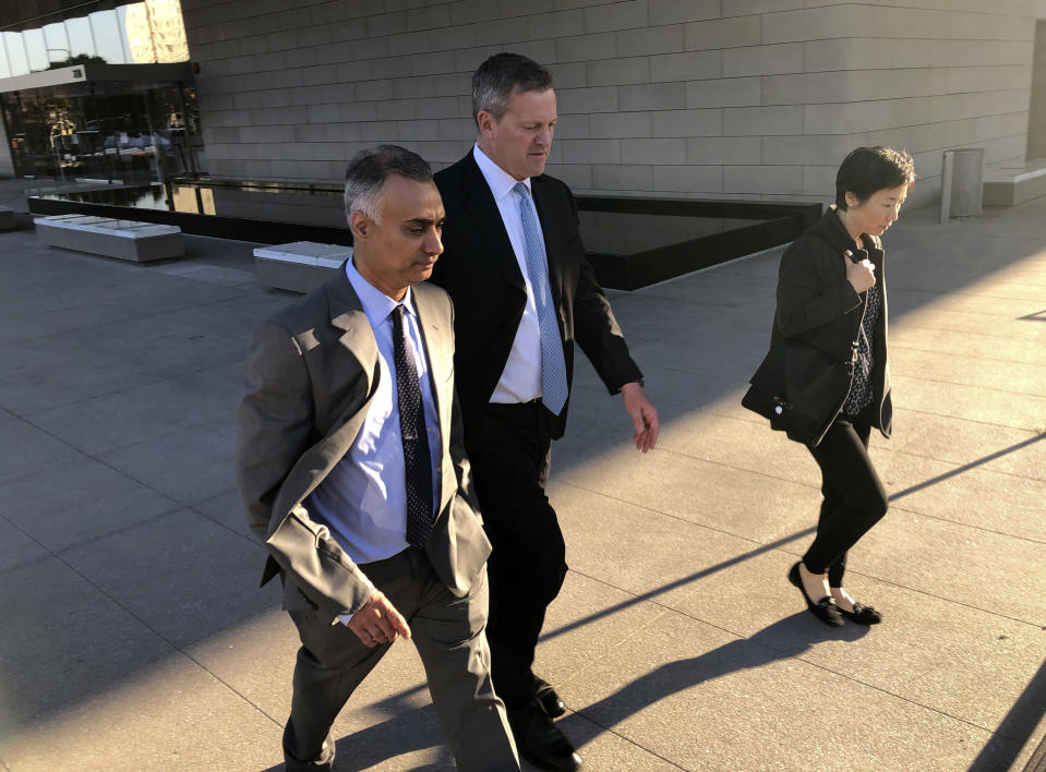 FILE - In this Friday, Nov. 22, 2019 file photo, Imaad Zuberi, left, leaves a federal courthouse with his attorney Thomas O'Brien, second from left, in Los Angeles. On Thursday, Feb. 18, 2021, Zuberi, a once high-flying political fundraiser who prosecutors say gave illegal campaign contributions to Joe Biden, Lindsey Graham and a host of other U.S. politicians while secretly working for foreign governments is set to be sentenced. (AP Photo/Brian Melley)