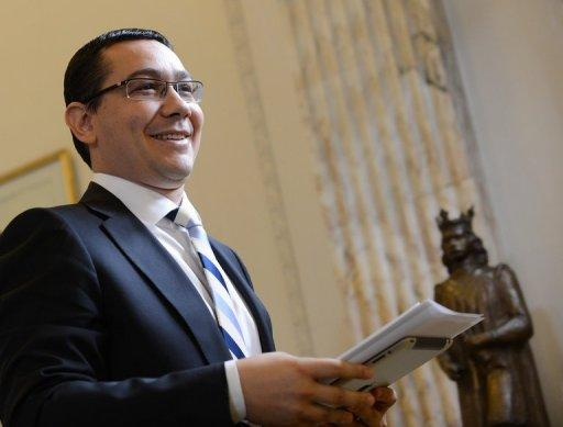 Romanian Prime Minister Victor Ponta leaves a press conference at the Romanian Parliament headquarters in Bucharest