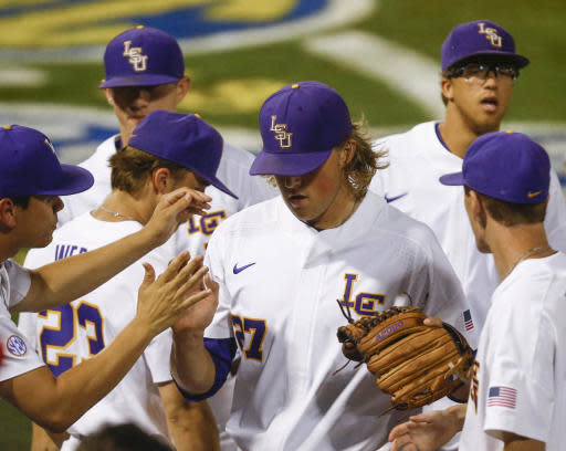 LSU pitcher Matthew Beck (27) is greeted by teammates as he walks off the field during the third inning of a Southeastern Conference tournament NCAA college baseball game against Florida, Friday, May 25, 2018, in Hoover, Ala. (AP Photo/Butch Dill)
