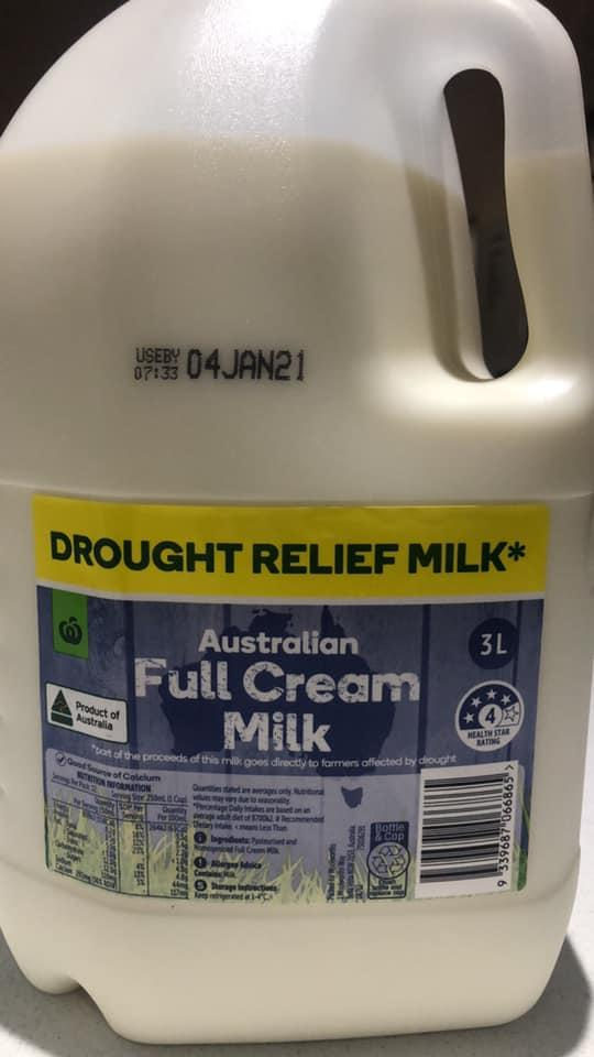 A four-litre carton of Woolworths milk is pictured.