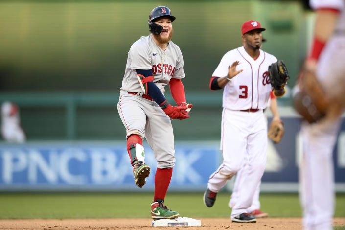 Boston Red Sox's Alex Verdugo reacts at second after he hit a double that scored two runs during the seventh inning of a baseball game against the Washington Nationals, Sunday, Oct. 3, 2021, in Washington. Nationals shortstop Alcides Escobar (3) is at right. The Red Sox won 7-5. (AP Photo/Nick Wass)