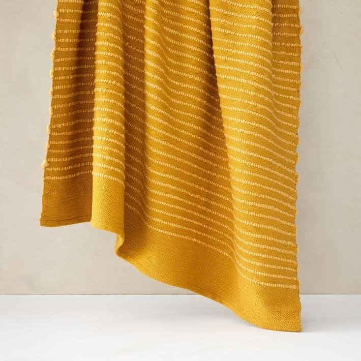 <p>Cozying up on the couch with a cozy blanket, like the <span>West Elm Soft Corded Throw</span> ($60), while watching never-ending reruns is my favorite PMS activity, if I'm being honest. </p>