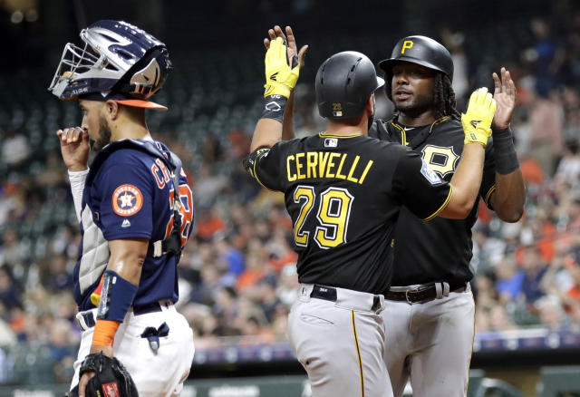 Pittsburgh Pirates' Francisco Cervelli (29) celebrates with Josh Bell, right, after they scored on Cervelli's home run as Houston Astros catcher Robinson Chirinos, left, looks toward the field during the first inning of an exhibition baseball game Monday, March 25, 2019, in Houston. (AP Photo/David J. Phillip)