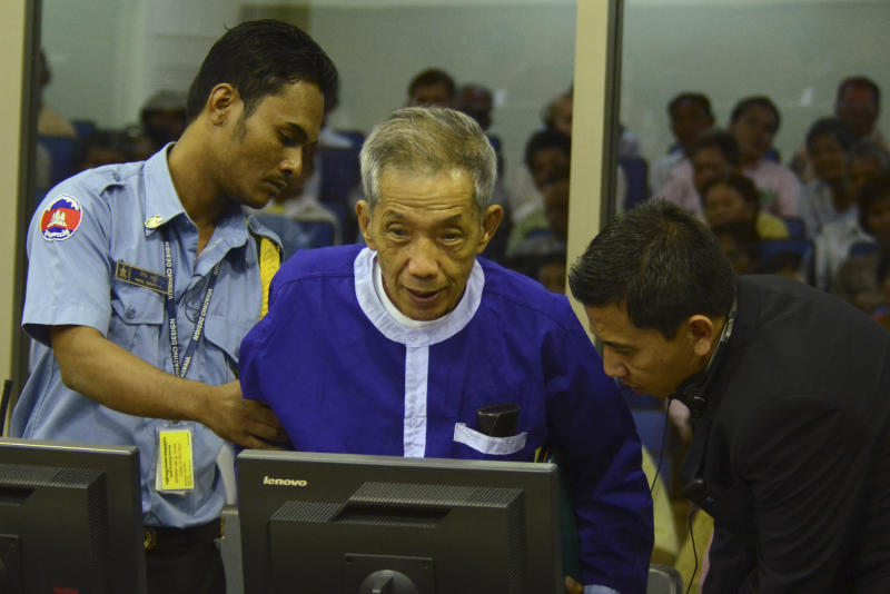 In this photo released by the Extraordinary Chambers in the Courts of Cambodia, Kaing Guek Eav, center, also known as Duch, who ran the notorious Toul Sleng prison, where up to 16,000 people were tortured before being killed,  appears during  testimony at the U.N.-backed war crimes tribunal in Phnom Penh, Cambodia, Monday, March 19, 2012.  The Khmer Rouge's chief jailer is scheduled to testify against three of the regime's surviving leaders who are accused of crimes against humanity. (AP Photo/Extraordinary Chambers in the Courts of Cambodia, Nhet Sok Heng)
