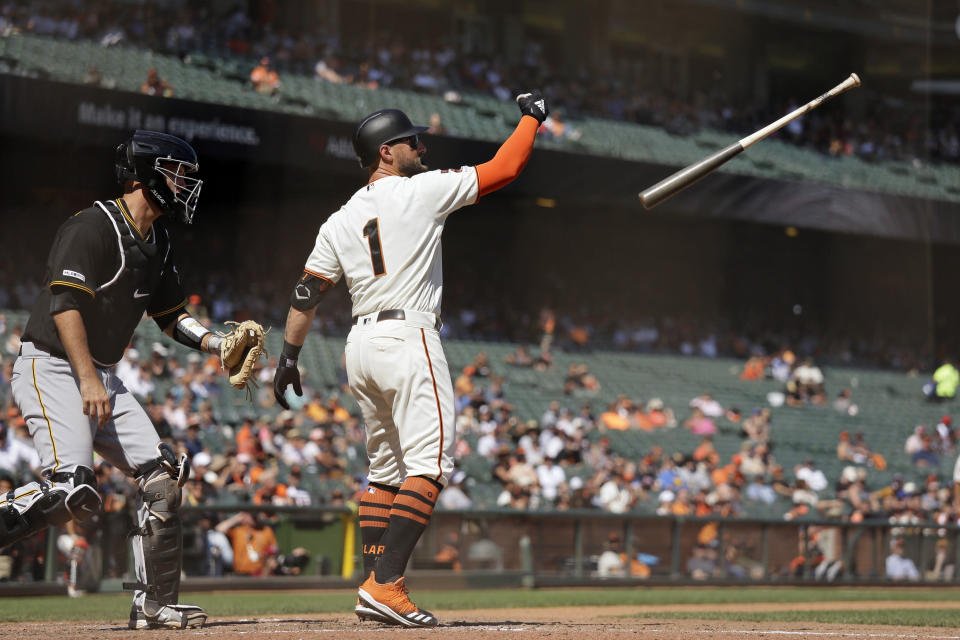 San Francisco Giants' Kevin Pillar loses his bat after striking out swinging against Pittsburgh Pirates relief pitcher Yacksel Rios in the sixth inning of a baseball game Thursday, Sept. 12, 2019, in San Francisco. Pirates catcher Jacob Stallings, left, looks on. (AP Photo/Eric Risberg)