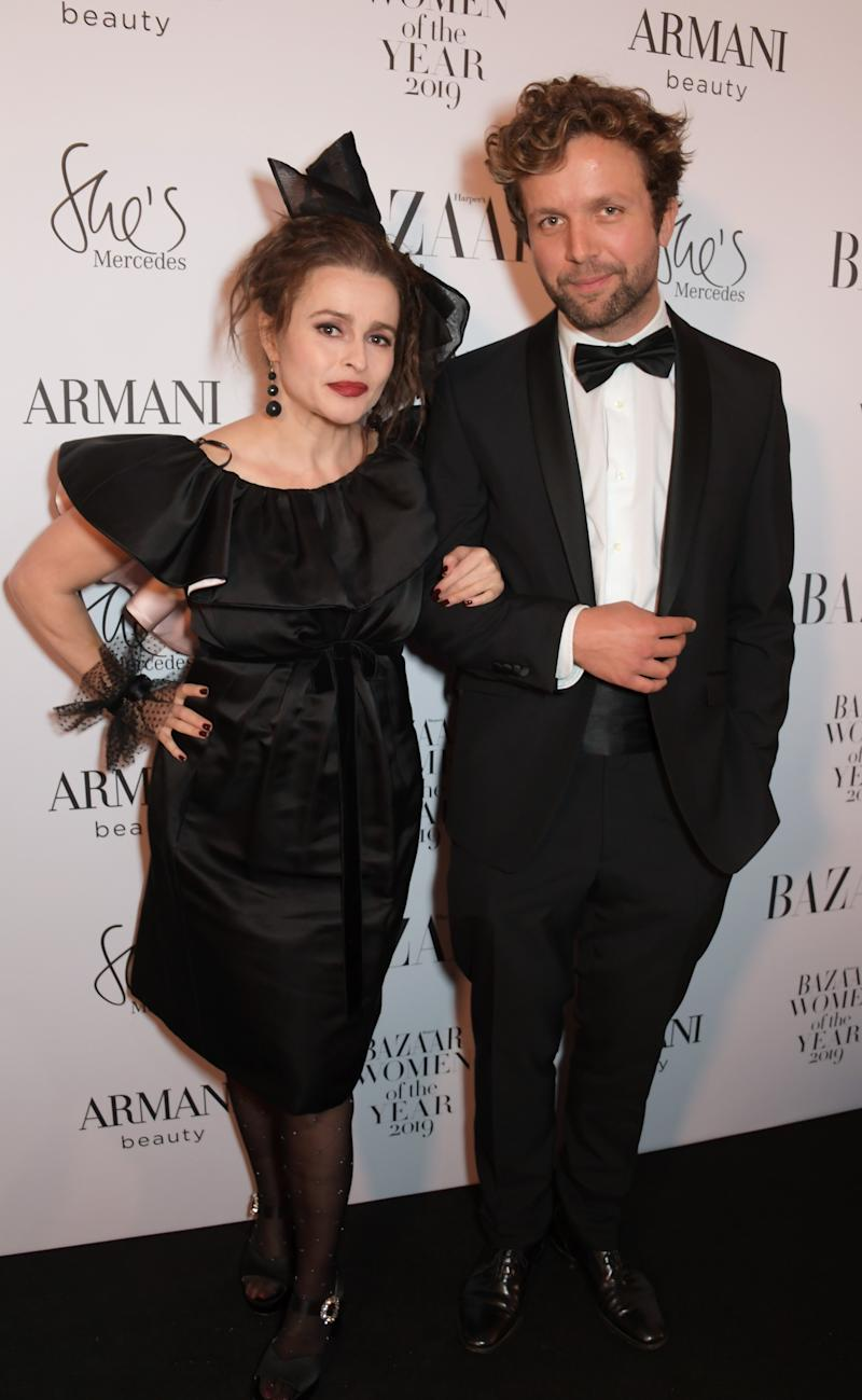LONDON, ENGLAND - OCTOBER 29: Helena Bonham Carter and Rye Dag Holmboe attend the Harper's Bazaar Women of the Year Awards 2019, in partnership with Armani Beauty, at Claridge's Hotel on October 29, 2019 in London, England. (Photo by David M. Benett/Dave Benett/Getty Images for Harper's Bazaar)