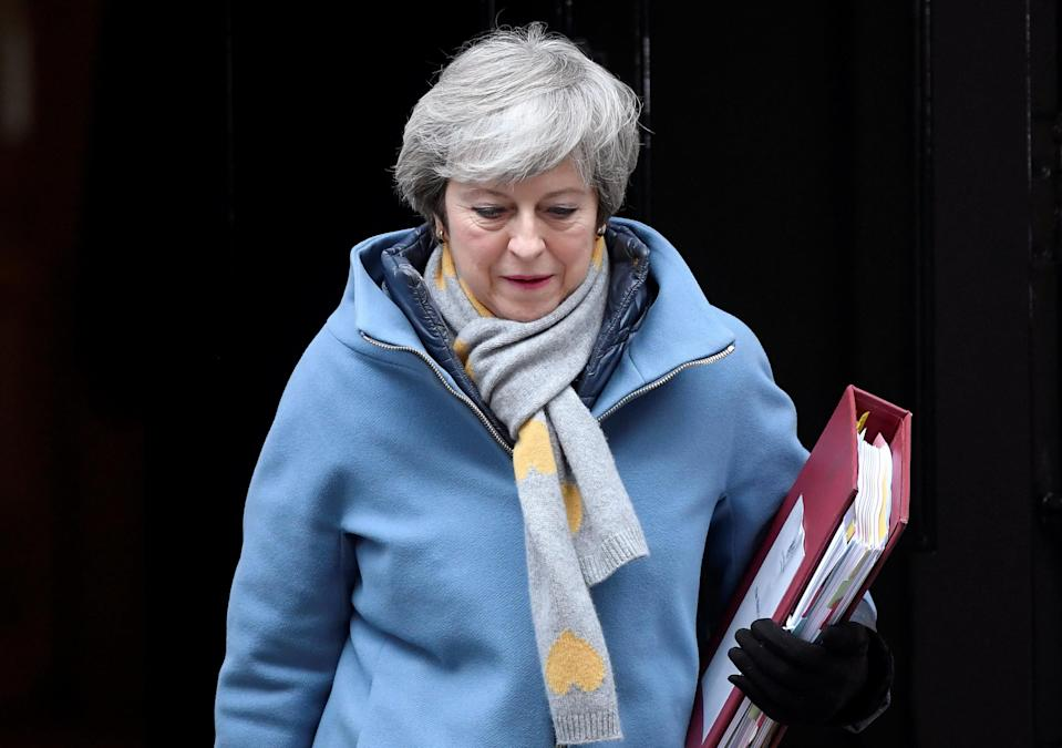 British Prime Minister Theresa May walks outside Downing Street in London, Britain March 13, 2019. REUTERS/Toby Melville