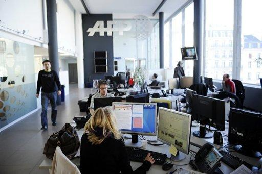 Journalists of Agence France-Presse work at headquarters in Paris