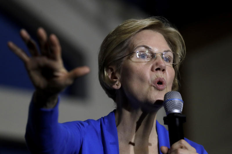 """FILE - In this Nov. 11, 2019 file photo, Democratic presidential candidate Sen. Elizabeth Warren, D-Mass., addresses an audience during a campaign event in Exeter, N.H. Warren's proposed wealth tax is putting her at odds with some of Wall Street's wealthiest, and the fight is increasingly spilling out into the open. In an interview on business new channel CNBC Thursday, Nov. 14, billionaire investor Leon Cooperman said Warren's plan to impose a new tax on the nation's richest people would """"penalize success"""" and that a Warren presidency would mean """"big trouble"""" for Wall Street and the country. (AP Photo/Steven Senne, File)"""