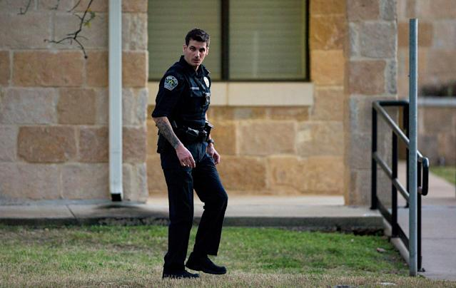 <p>An Austin police officer secures the scene near another explosion in the 9800 block of Brodie Lane in Austin, Texas, on Tuesday, March 20, 2018. Emergency teams were responding to another reported explosion in Texas' capital, this one at a Goodwill store in the southern part of the city. (Photo: Nick Wagner/Austin American-Statesman via AP) </p>