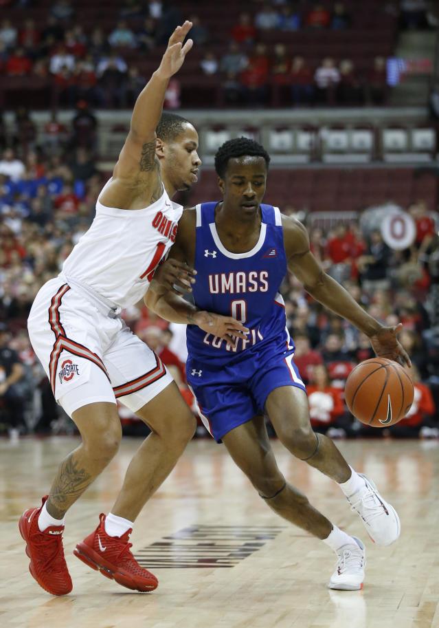 Massachusetts-Lowell's Ron Mitchell, right, drives to the basket as Ohio State's C.J. Walker defends during the first half of an NCAA college basketball game Sunday, Nov. 10, 2019, in Columbus, Ohio. (AP Photo/Jay LaPrete)