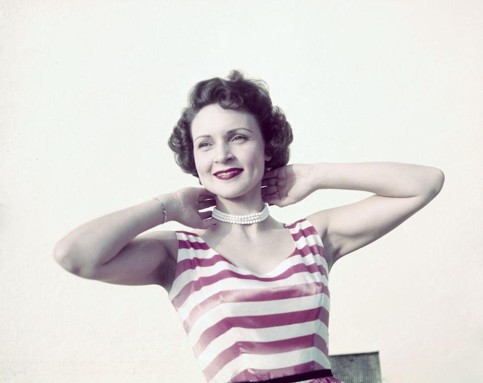 <p>Betty was such a, well, a Betty! She's giving off major bombshell vibes in this striped shirt in the mid '50s. </p>