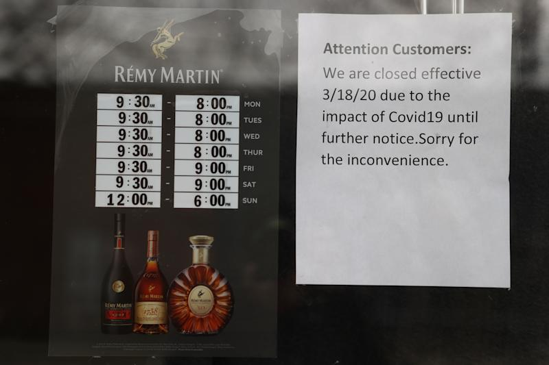 MERRICK, NEW YORK - MARCH 31: A sign at Frank's Liquor store states that the store is closed due to the coronavirus pandemic on March 31, 2020 in Merrick, New York. The World Health Organization declared coronavirus (COVID-19) a global pandemic on March 11. (Photo by Al Bello/Getty Images)